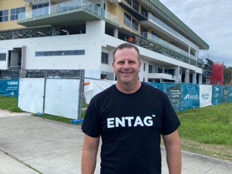 Kris Carver ENTAG business CEO in front of Vitality Village